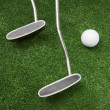 Royalty-Free Stock Photo: Two clubs and ball