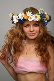 Girl with a wreath of flowers on her hea — Stock Photo