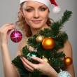 Royalty-Free Stock Photo: Girl with Christmas tree in the hands