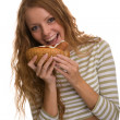 Girl eating hot dog — Stock Photo #1044066
