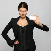 Girl holding a business card — Stock Photo
