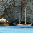 Stock Photo: Sailor Under Rocky Coast Of Sardinia
