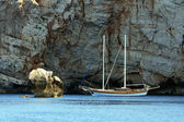Sailor Under Rocky Coast Of Sardinia — Stock Photo