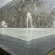 Louvre, fountain and pyramid — Stock Photo