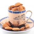 Royalty-Free Stock Photo: Almonds in a coffee cup