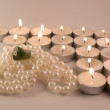 Necklace, ring and candles — Stock Photo