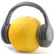 Stock Photo: Headphones on melon