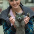 Pretty brunette with cat — Stock Photo