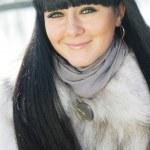 Pretty girl in fur coat — Stock Photo