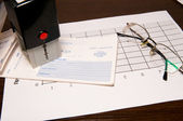 Stamp, blank check and glasses — Stock Photo
