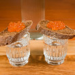 Two glasses of vodka and sandwich — Stock Photo