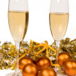 Two glasses of champagne and Christmas o - Stock Photo