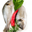 Two fresh fishes and vegetables. - Stock Photo