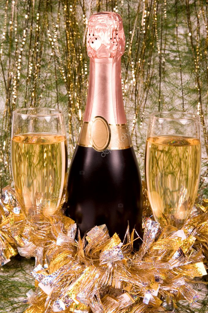 Bottle of champagne and full glasses for a meeting of New year. — Stock Photo #1031074