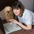 Royalty-Free Stock Photo: Girl with a dog and the laptop