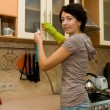 A woman  cleaning  a kitchen — Stock Photo