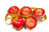 Apples and measuring tape — Stock Photo