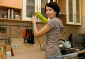 A woman cleaning a kitchen — Stok fotoğraf