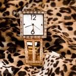 Female gold watch — Stock Photo