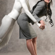 Beautiful woman and a male mannequin — Stock Photo