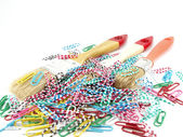 Paint brushes and striped clips — Stock Photo