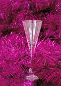 One glass in the tinsel — Stock Photo