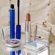 Stock Photo: Cosmetics on mirror