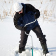 Fisherman with ice-drill — Stock Photo #2654364