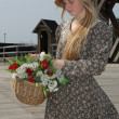Stock Photo: Girl with basket of flowers