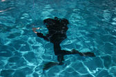 Diver moving underwater — Stock Photo