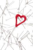 Heart and needles — Stock Photo