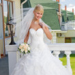 Bride on the balcony - Stock Photo