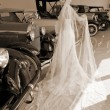 Stock Photo: Bride and antique cars