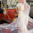 Bride and antique car — Stock Photo