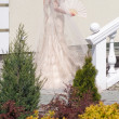 Bride in the garden - Stock Photo