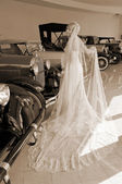 Bride and antique cars — Stock Photo