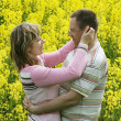 Couple in flower meadow - Stock Photo