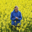 Man in flower meadow - Stock Photo