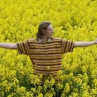 Young man in meadow - Stock Photo