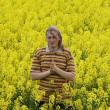Men in yellow flowers - Stock Photo