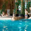Family in swimming-pool — Stock Photo