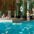 Stock Photo: Family in swimming-pool