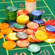 Large group of chips on green baize — Stock Photo #1018744