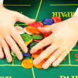 Players hands and chips — Stock Photo #1018806