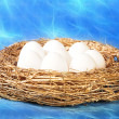 Royalty-Free Stock Photo: White eggs in golden nest