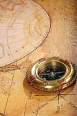 Old-fashioned compass on a background — Stock Photo