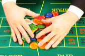 Players hands and chips — Stock Photo
