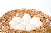 White eggs in golden nest — Stock Photo