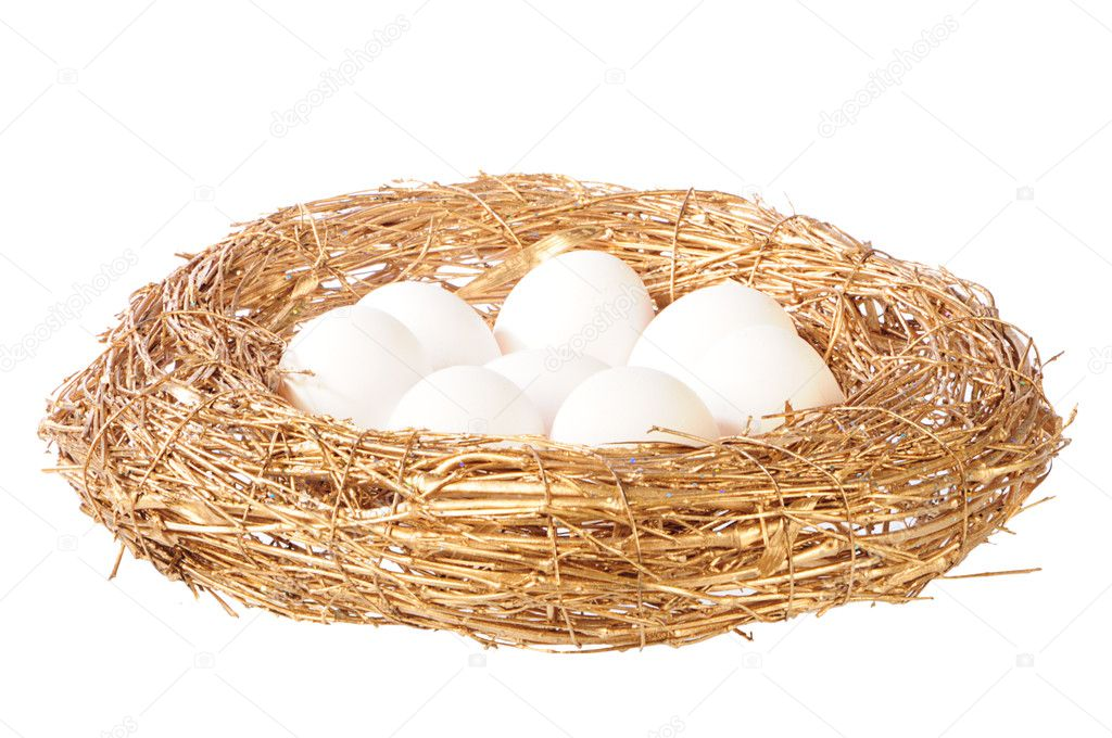 White eggs in golden nest — Stock Photo #1019371