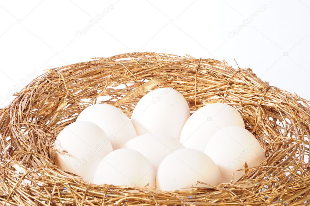 White eggs in golden nest — Stock Photo #1019391